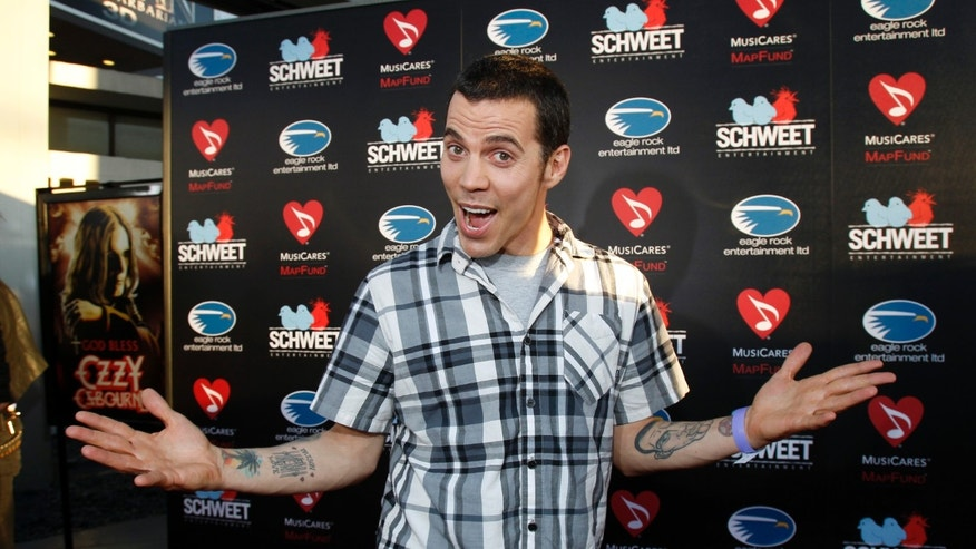 """August 22, 2011. Steve-O poses at a private preview of the documentary """"God Bless Ozzy Osbourne"""" at the Arclight Cinerama Dome in Hollywood, California."""
