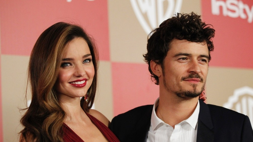 Actor Orlando Bloom (R) and model Miranda Kerr pose at the InStyle/Warner Bros. after party following the 70th annual Golden Globe Awards in Beverly Hills, California January 13, 2013.
