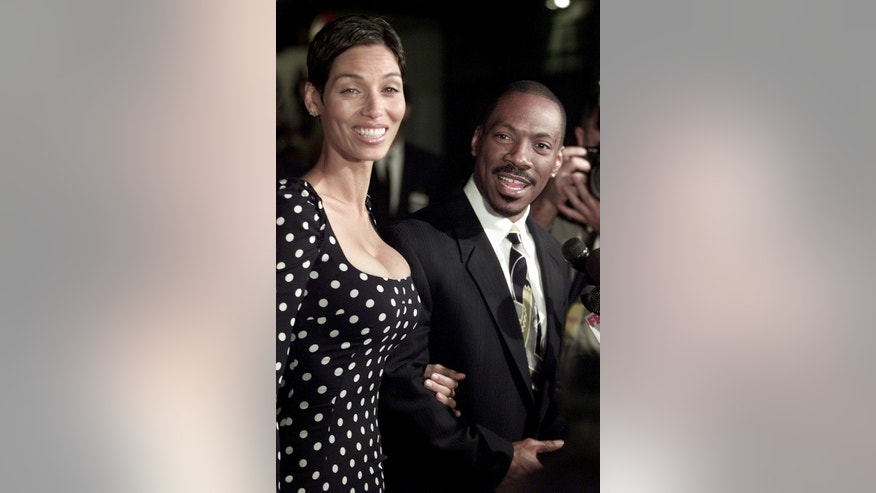 "Eddie Murphy and his wife Nicole react while giving an interview at the premiere of ""Showtime,"" on March 11, 2002 in Los Angeles, California. ""Showtime"" opens in the United States on March 15, 2002."