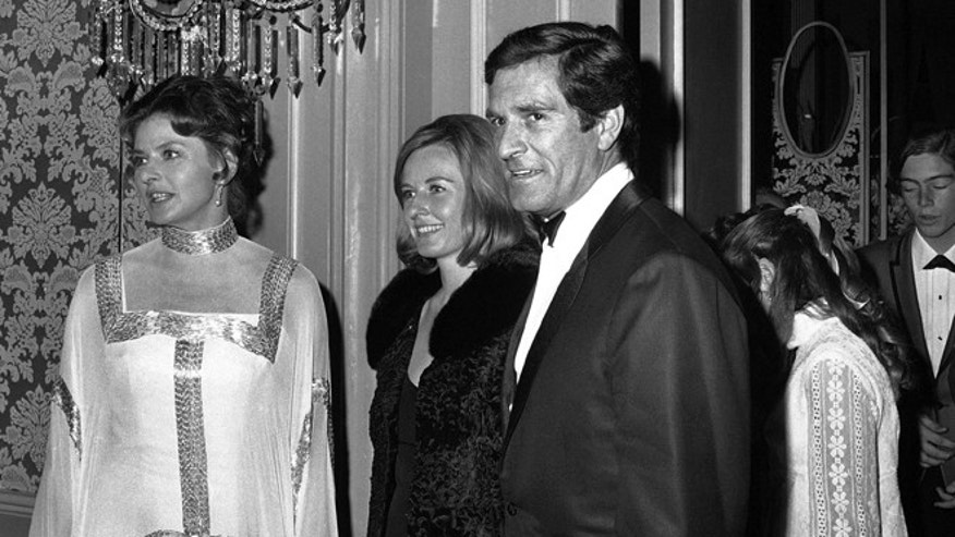 Ingrid Bergman, her daughter Pia, and Hugh O'Brien arrive at Beverly Hilton for dinner in Hollywood, California on April 14, 1969. They sat at same table too all evening. (AP Photo/David Smith)