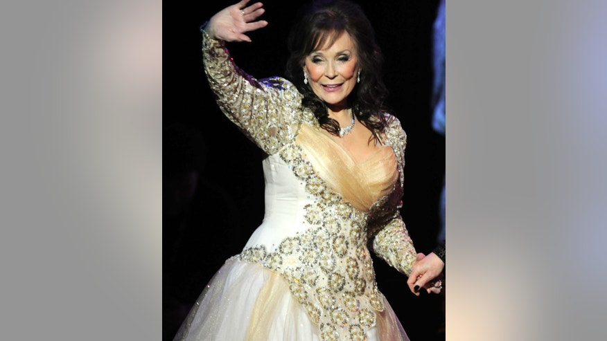 "Country legend Loretta Lynn waves after performing during the ""Grammy Salute to Country Music honoring Loretta Lynn"" in Nashville, Tennessee, October 12, 2010."