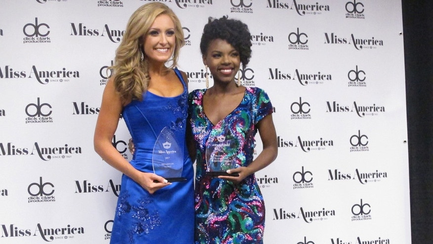 Miss Tennessee Grace Burgess, left, and Miss District of Columbia Cierra Jackson, right, speak with reporters after winning preliminary competitions in the first night of the Miss America pageant in Atlantic City, Tuesday, Sept. 6, 2016.
