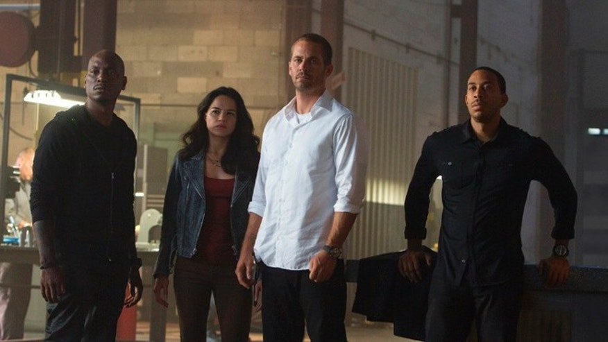 "Tyrese Gibson, Michelle Rodriguez, Paul Walker and Chris ""Ludacris"" Bridges in the film, ""Furious 7,"" directed by James Wan."