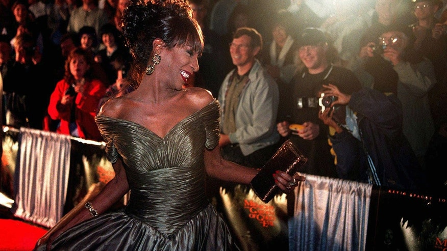 "In this Thursday, Nov. 20, 1997 file photo, The Lady Chablis twirls for the crowd awaiting the stars of the movie ""Midnight in the Garden of Good and Evil"" to arrive for the premier screening in Savannah, Ga."