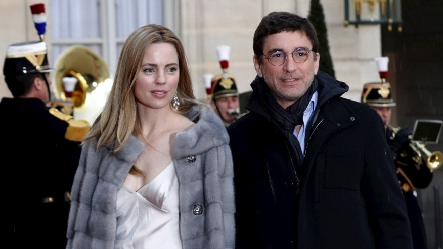 Australian actress Melissa George and her companion Jean-David Blanc arrive to attend a dinner given in honor of Australia's Governor-General Peter Cosgrove at the Elysee palace in Paris, France, April 26, 2016.