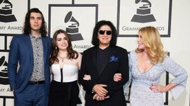 Musician Gene Simmons with his family, son Nick Simmons (L), daughter Sophie Simmons and wife Shannon Tweed (R) arrive at the 58th Grammy Awards in Los Angeles, California February 15, 2016.  REUTERS/Danny Moloshok - RTX273GG