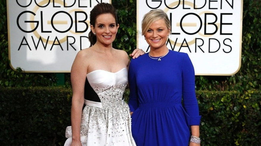 Tina Fey and Amy Poehler at the 72nd Golden Globe Awards in 2015.