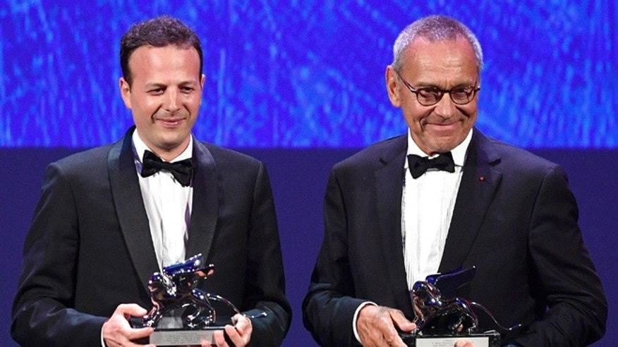 "Mexican film director, producer and screenwrite Amat Escalante, left, holds the Silver Lion award for his movie ""La Region Salvaje"" (The Untamed) flanked by Russian director Andrei Konchalovsky, holding the Silver Lion award for his movie ""Paradise"" during the awards ceremony of the 73rd Venice International Film Festival, in Venice, Italy, Saturday, Sept. 10, 2016. (Ettore Ferrari/ANSA via AP)"