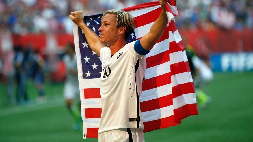 Jul 5, 2015; Vancouver, British Columbia, CAN; United States forward Abby Wambach (20) celebrates after defeating Japan in the final of the FIFA 2015 Women's World Cup at BC Place Stadium. United States won 5-2. Mandatory Credit: Michael Chow-USA TODAY Sports  - RTX1J59T