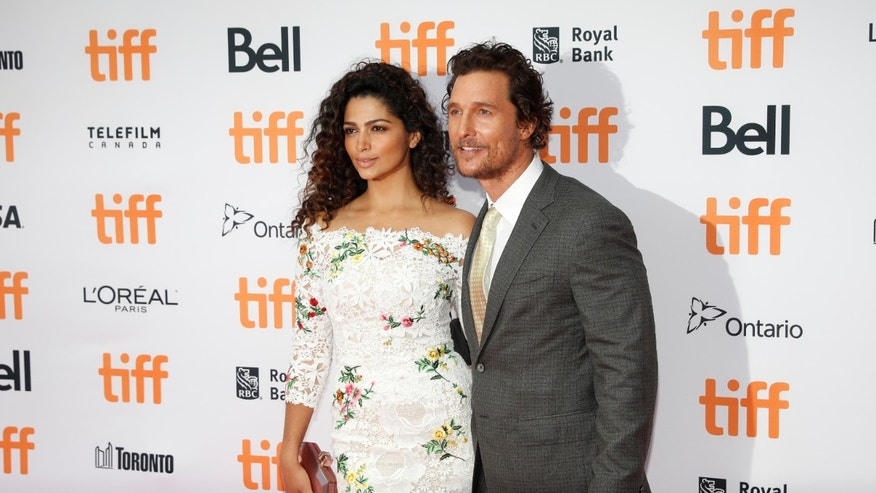 "Actor Matthew McConaughey arrives with his wife Camila Alves on the red carpet for the film ""Sing"" during the Toronto International Film Festival (TIFF) in Toronto, Canada, September 11, 2016."