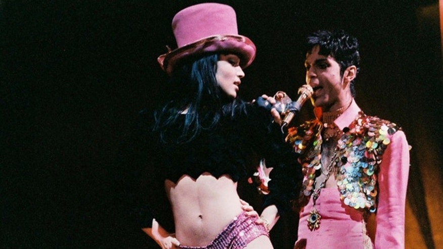 LONDON, UNITED KINGDOM - MARCH 4: Mayte Garcia and Prince perform on stage on 'The Ultimate Live Experience' tour at Wembley Arena on March 4th, 1995 in London, United Kingdom. (Photo by Peter Still/Redferns)