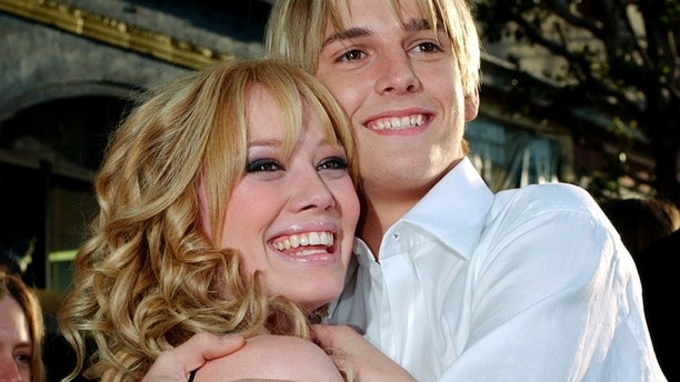Actress Hillary Duff and friend, singer Aaron Carter, arrive to the