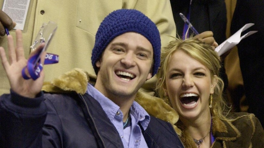 In this Feb. 10, 2002, file photo, Justin Timberlake and Britney Spears wave to the crowd prior to the start of the 2002 NBA All-Star game in Philadelphia.