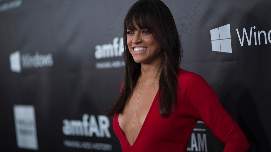 Actress Michelle Rodriguez poses at amfAR's Fifth Annual Inspiration Gala in Los Angeles, California October 29, 2014.