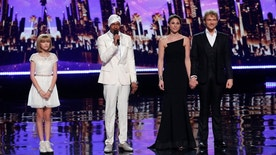 "Grace VanderWaal (left) and The Clairvoyants (right) wait to hear host Nick Cannon (center) annouce the ""America's Got Talent"" winner."
