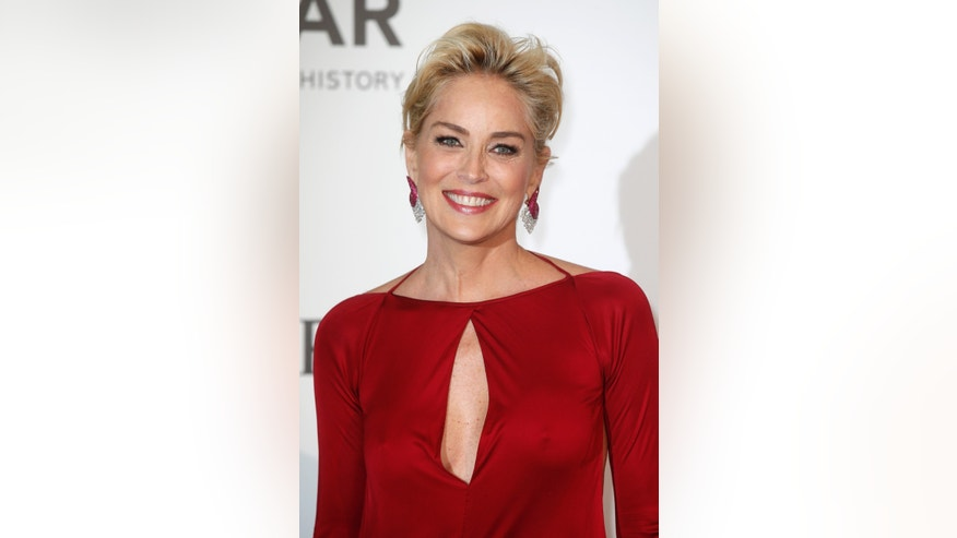 Actress Sharon Stone arrives for amfAR's Cinema Against AIDS 2014 event in Antibes during the 67th Cannes Film Festival May 22, 2014. REUTERS/Benoit Tessier (FRANCE - Tags: ENTERTAINMENT) - RTR3QGH6