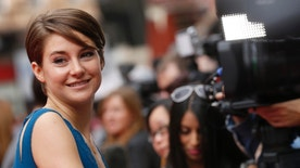 """Actress Shailene Woodley smiles as she arrives for the European premiere of """"Divergent"""" at Leicester Square in London March 30, 2014.  REUTERS/Luke Macgregor (BRITAIN  - Tags: ENTERTAINMENT SOCIETY)   - RTR3J7GS"""
