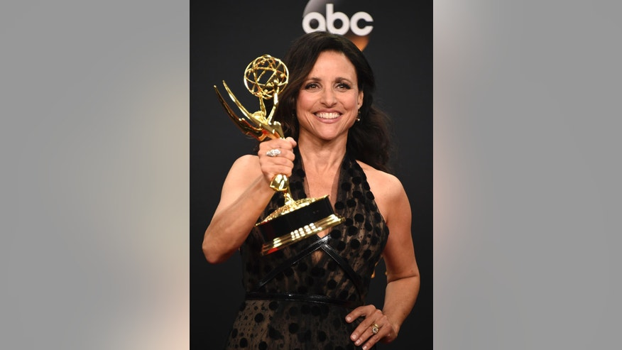 """Julia Louis-Dreyfus winner of the award for outstanding lead actress in a comedy series for """"Veep"""" poses in the press room at the 68th Primetime Emmy Awards on Sunday, Sept. 18, 2016, at the Microsoft Theater in Los Angeles. (Photo by Jordan Strauss/Invision/AP)"""