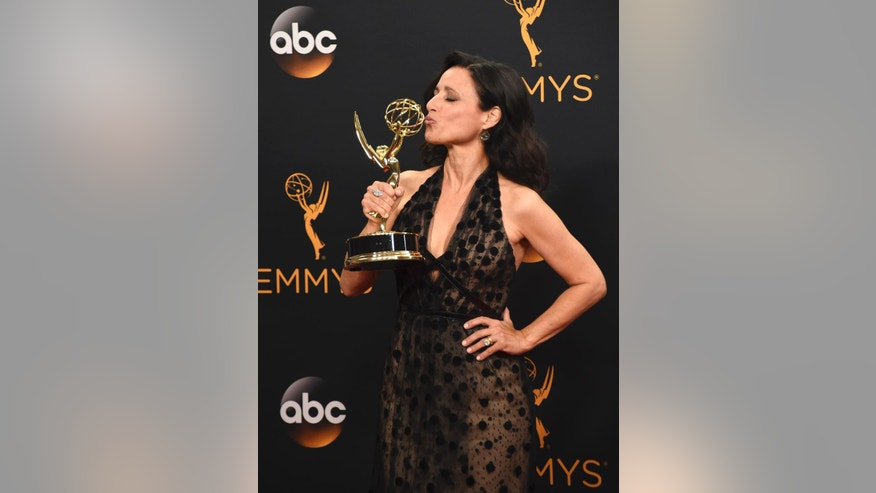 "Julia Louis-Dreyfus winner of the award for outstanding lead actress in a comedy series for ""Veep"" poses in the press room at the 68th Primetime Emmy Awards on Sunday, Sept. 18, 2016, at the Microsoft Theater in Los Angeles. (Photo by Jordan Strauss/Invision/AP)"