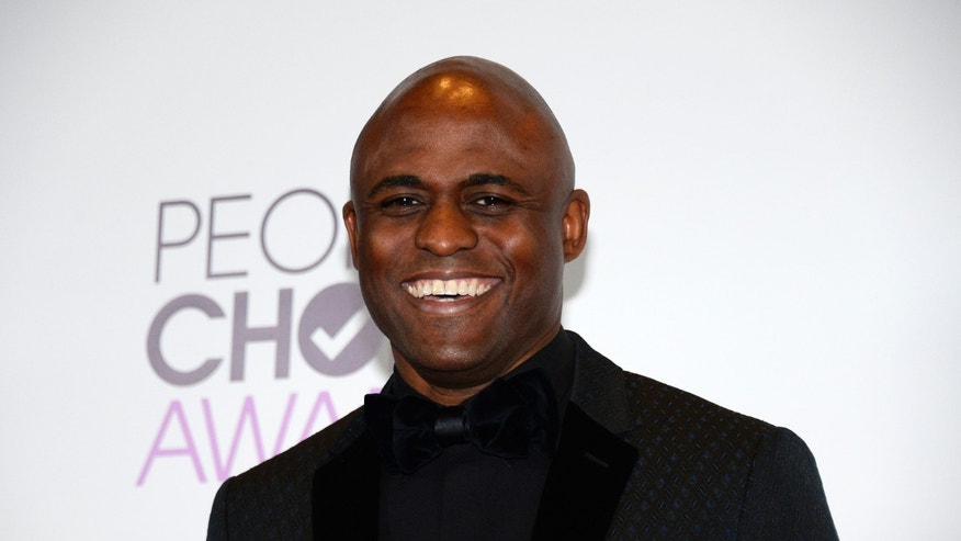 Wayne Brady poses backstage at the 2014 People's Choice Awards in Los Angeles, California January 8, 2014.