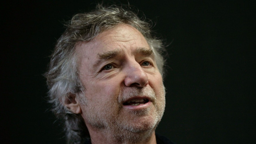 FILE - In this Dec. 1, 2009 file photo, U.S. filmmaker Curtis Hanson, speaks during an interview at the International Book Fair in Guadalajara, Mexico.
