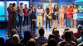 The cast of Big Brother 18 with host Julie Chen on the Big Brother season 18 live finale.