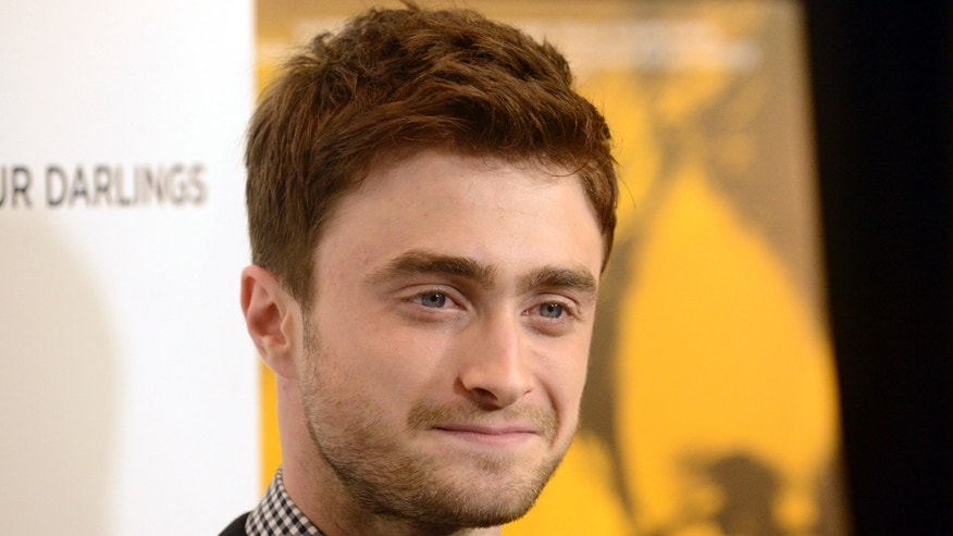 "Cast member Daniel Radcliffe attends the film premiere of ""Kill Your Darlings"" in Beverly Hills, California October 3, 2013. REUTERS/Phil McCarten (UNITED STATES - Tags: ENTERTAINMENT) - RTR3FKW1"