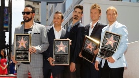 Backstreet Boys (from L-R) A. J. McLean, Howie Dorough, Kevin Richardson, Nick Carter and Brian Littrell pose on their star after it was unveiled on the Walk of Fame in Los Angeles, California April 22, 2013. REUTERS/Mario Anzuoni  (UNITED STATES - Tags: ENTERTAINMENT) - RTXYW84