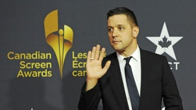 TV personality George Stroumboulopoulos arrives during the Canadian Screen Awards in Toronto March 3, 2013.  REUTERS/Jon Blacker (CANADA  - Tags: ENTERTAINMENT TPX IMAGES OF THE DAY)