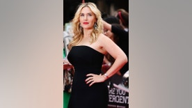 "Actress Kate Winslet poses for a photograph as she arrives for the European premiere of ""Divergent"" at Leicester Square in London March 30, 2014.    REUTERS/Luke Macgregor (BRITAIN  - Tags: ENTERTAINMENT SOCIETY)   - RTR3J79W"
