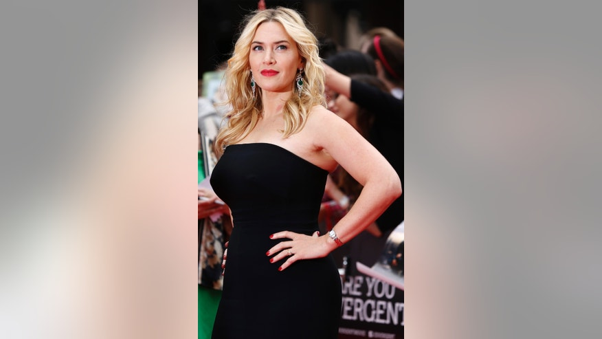 "Actress Kate Winslet poses for a photograph as she arrives for the European premiere of ""Divergent"" at Leicester Square in London March 30, 2014."