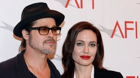 Actor Brad Pitt and actress/director Angelina Jolie pose at the AFI Awards 2014 honoring excellence in film and television in Beverly Hills, California, U.S. on January 9, 2015. REUTERS/Kevork Djansezian/File Photo - RTSOLP4