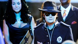 """Actor Corey Feldman arrives at the memorial service for Michael Jackson at the Staples Center in Los Angeles July 7, 2009. Michael Jackson's family and close friends held a private service at a Los Angeles cemetery on Tuesday as fans crowded into the city's downtown area for a star-packed public memorial to the """"King of Pop.""""  REUTERS/Wally Skalij/Pool     (UNITED STATES) - RTR25F4M"""
