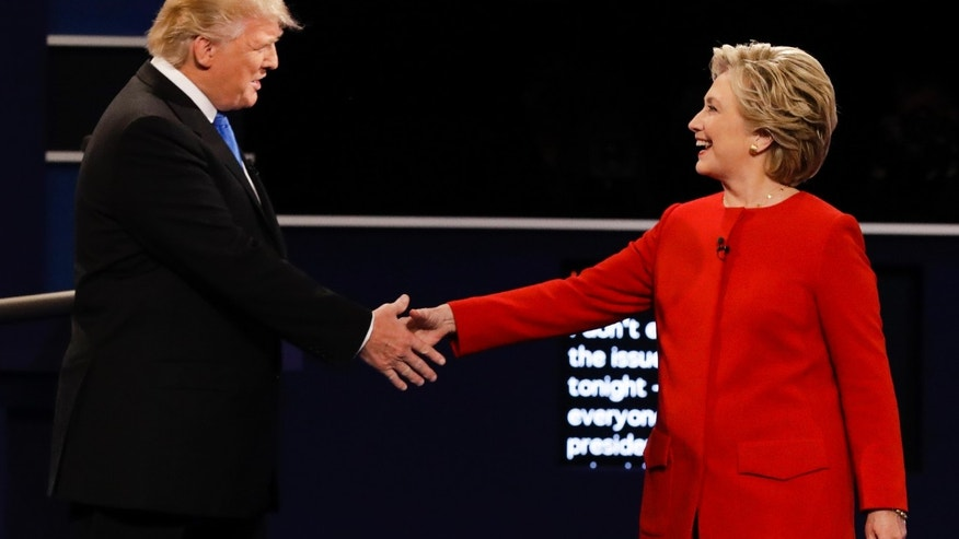 Republican presidential nominee Donald Trump and Democratic presidential nominee Hillary Clinton shake hands during the presidential debate at Hofstra University in Hempstead, N.Y., Monday, Sept. 26, 2016.