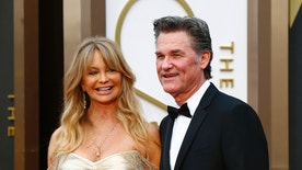 Actors Goldie Hawn and Kurt Russell arrive at the 86th Academy Awards in Hollywood, California March 2, 2014.