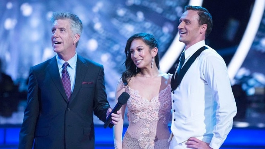 "In this Sept. 12, 2016 photo released by ABC, host Tom Bergeron, from left, appears with Cheryl Burke and US Olympic swimmer Ryan Lochte during a broadcast of the celebrity dance competition series, ""Dancing with the Stars,"" in Los Angeles. (Eric McCandless/ABC via AP)"