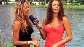 Venezuela's former Miss Universe, Alicia Machado (R), talks to Colombian model Nathalia Paris, November 14. Machado, whose reign as Miss Universe was fraught with controversy over her ballooning weight, is in Colombia's Caribbean coast resort of Cartagena as a presenter for the Caracol television network. Twenty three young women from across the country are competing this wekend for the prize title of Miss Colombia, a beauty pageant that each year deflects Colombians' attention from the country's bitter civil conflict and provides them with a touch of glamour. - RTXHVO6