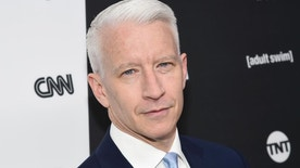 """FILE - In this May 18, 2016 file photo, CNN news anchor Anderson Cooper attends the Turner Network 2016 Upfronts in New York. Cooper signed a long-term deal to stay with CNN, a person with knowledge of the agreement said Tuesday, Oct. 4. His decision may put an end to the possibility he'll join Kelly Ripa as co-host of ABC's """"Live."""" She reportedly favored him to replace Michael Strahan, who jumped to ABC's """"Good Morning America."""" (Photo by Evan Agostini/Invision/AP, File)"""