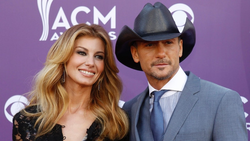 Singer Faith Hill and her husband Tim McGraw arrive at the 48th ACM Awards in Las Vegas April 7, 2013.