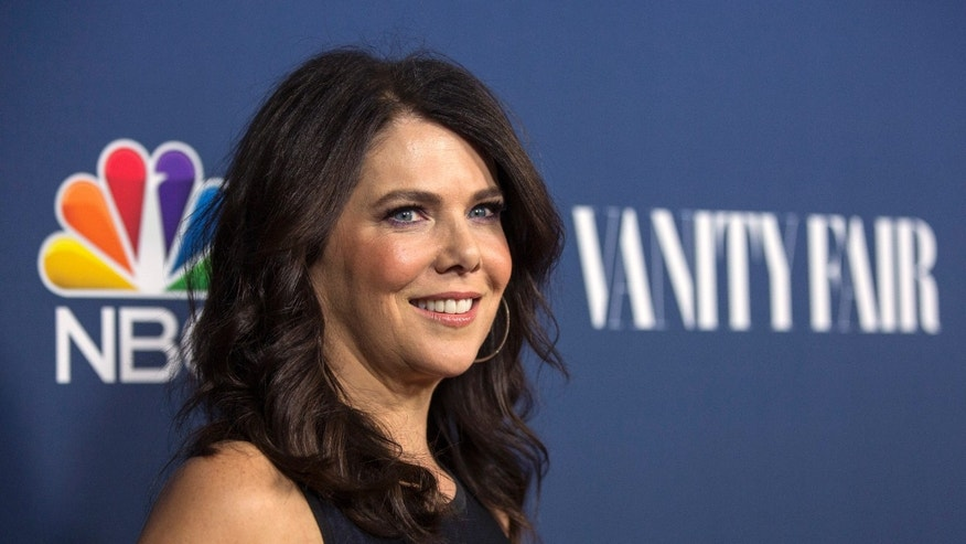"Actress Lauren Graham from the television series ""Parenthood"" poses at NBC and Vanity Fair's 2014-2015 television season event in Los Angeles, California September 16, 2014. REUTERS/Mario Anzuoni  (UNITED STATES - Tags: ENTERTAINMENT) - RTR46ILS"