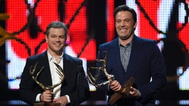 File-This June 4, 2016, file photo shows, Matt Damon, left, and Ben Affleck accepting the guys of the decade award at the Guys Choice Awards at Sony Pictures Studios on in Culver City, Calif. Damon and Affleck resurrected their 'Good Will Hunting roles, not to mention their Boston accents, in a special one night only live read from the script Friday, Oct. 7, 2016,  in New York. John Krasinski hosted and served as a guest director of the read before an audience that benefits a non-profit arts organization called Film Independent. (Photo by Chris Pizzello/Invision/AP, File)