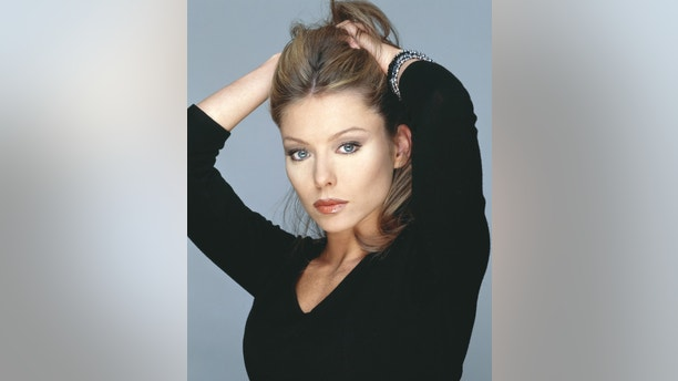 Soap opera actress Kelly Ripa was named on February 5, 2001 to join [Regis Philbin] as permanent co-host on the daytime talk show, ``Live with Regis.'' Ripa replaces [Kathie Lee Gifford], who left the show last summer, and will officially join the show on February  12. - RTXKAY2