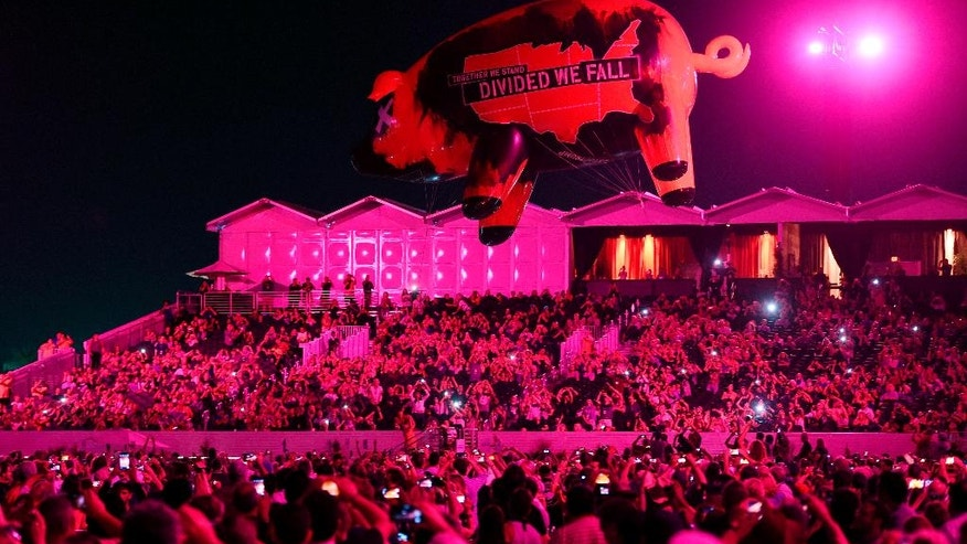 A giant inflatable pig soars over the crowd during Roger Waters' set on day 3 of the 2016 Desert Trip music festival at Empire Polo Field on Sunday, Oct. 9, 2016, in Indio, Calif. (Photo by Chris Pizzello/Invision/AP)
