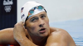United States' Ryan Lochte checks his time in a men's 4x200-meter freestyle heat during the swimming competitions at the 2016 Summer Olympics, Tuesday, Aug. 9, 2016, in Rio de Janeiro, Brazil. (AP Photo/Michael Sohn)