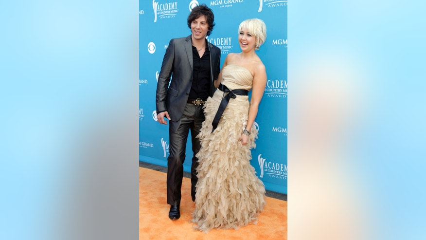 Meghan Linsey (R) and Joshua Scott Jones of the former country music duo Steel Magnolia at the 45th annual Academy of Country Music Awards in Las Vegas, Nevada April 18, 2010.