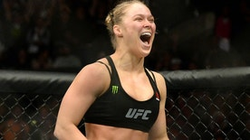 Feb 28, 2015; Los Angeles, CA, USA; Ronda Rousey (red gloves) reacts after defeating Cat Zingano (not pictured) during their women's bantamweight title bout at UFC 184 at Staples Center. Rousey won in 14 seconds of the first round. Mandatory Credit: Jayne Kamin-Oncea-USA TODAY Sports - RTR4RL9J