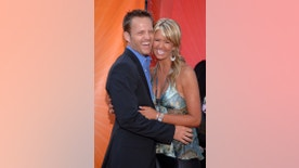 Actress Nancy O'Dell (R) and husband Keith Zubchevich arrive at the NBC Allstar Party held at the Century Club in Los Angeles July 25, 2005. REUTERS/Phil McCarten  PM/KS - RTRIOBH