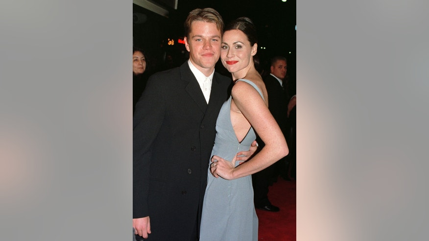 "Actors Matt Damon and Minnie Driver, stars of the new film ""Good Will Hunting"" pose together as they arrive for the film's premiere December 2, 1997 in Los Angeles."