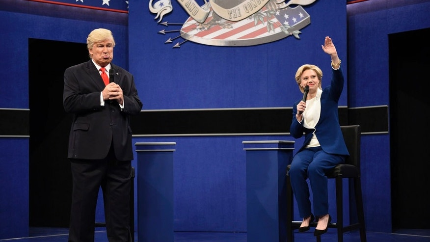 "SATURDAY NIGHT LIVE -- ""Emily Blunt"" Episode 1707 -- Pictured: (l-r) Alec Baldwin as Republican Presidential Candidate Donald Trump and Kate McKinnon as Democratic Presidential Candidate Hillary Clinton during the ""Debate Cold Open"" sketch on October 15, 2016 -- (Photo by: Will Heath/NBC)"
