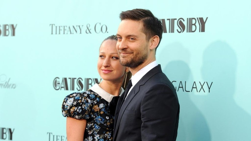 "FILE - In this May 1, 2013, file photo, actor Tobey Maguire, right, and wife Jennifer Meyer attend ""The Great Gatsby"" world premiere in New York. A representative for Maguire confirmed a People magazine report on Oct. 18, 2016, that Maguire and Meyer have separated after nine years of marriage. (Photo by Evan Agostini/Invision/AP, File)"